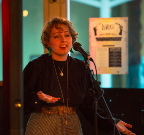 Kym Wins Out-Spoken Poetry Prize
